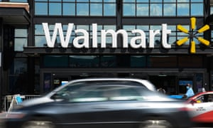 Cars drive past a Walmart store in Washington, DC.