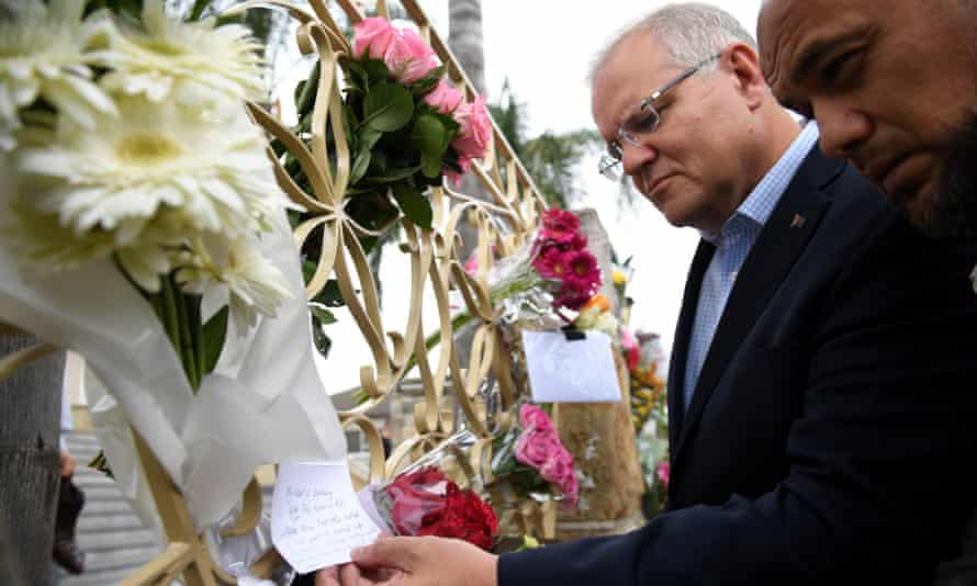 Australian prime minister Scott Morrison (2-R) looks at floral tributes to the victims of the Christchurch terror attack during a visit to the Lakemba Mosque, south west Sydney, Australia, 16 March 2019.