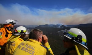 Firefighters from the New South Wales Rural Fire Service monitor the remnants of the Ruined Castle fire in the Jamieson Valley from Echo Point lookout in Katoomba, Blue Mountains.