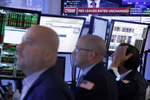 Traders work in a booth on the floor of the New York Stock Exchange, Thursday, Sept. 17, 2015. The Federal Reserve is keeping U.S. interest rates at record lows in the face of threats from a weak global economy, persistently low inflation and unstable financial markets. (AP Photo/Richard Drew)