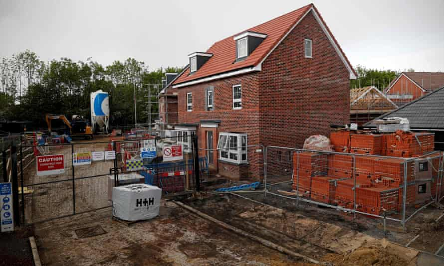 A notice at a housing development reads 'site closed fill further notice'