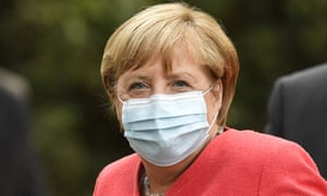 German chancellor Angela Merkel wears a face mask during her visit to Duesseldorf on Tuesday