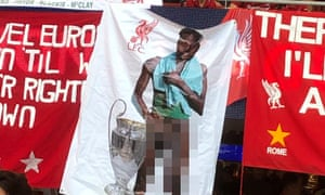 The contorversial banner of Divock Origi on display in the Liverpool section during June's Champions League Final at the Estadio Metropolitano