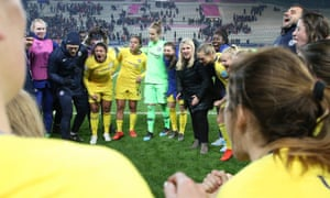 Emma Hayes and her team celebrate victory over Paris Saint-Germain in last season's Champions League quarter-finals.