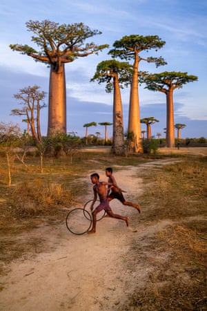 Boys playing with hoops in Madagascar