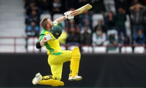 David Warner celebrates a century which set up Australia's Cricket World Cup victory against Pakistan with a flying leap.