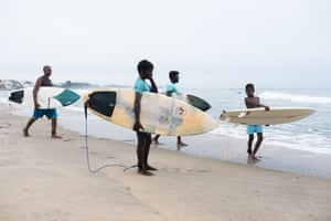 Mumu surf school provides boards to young local surfers who help with beach clean-ups