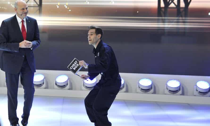 Volkswagen's Jürgen Stackmann looks on as comedian Simon Brodkin disrupts the Volkswagen press conference.