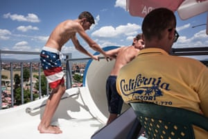 Eddie Steven, wearing American flag shorts, is the son of the owner of the California Resort on the outskirts of Pristina