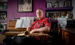 Archie Tulk, 16, in the front room of his home in Birmingham