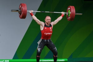 Welsh weightlifter Gareth Evans who secured gold in the men's 69kg category by lifting 299kg.