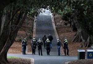 Police patrol Treasury Gardens in Melbourne on Saturday.