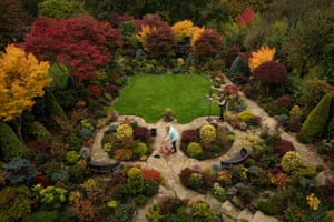 Retired couple Tony and Marie Newton tend to their four seasons garden as it bursts into autumnal colour in Walsall, UK