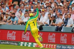 Khawaja celebrates taking the catch.