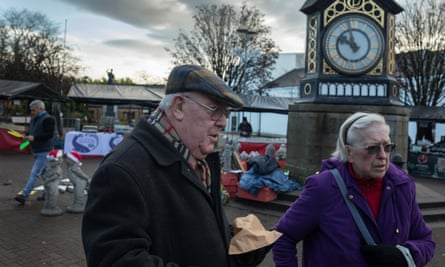Larry, who voted for the SNP, and Moira MacDougall, who voted for the Lib Dems, discuss their choices in Milngavie town centre.