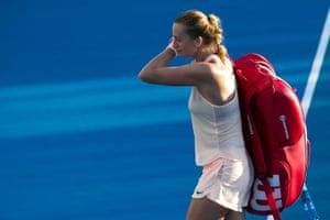 Petra Kvitova walks off in tears after losing to Andrea Petkovic.