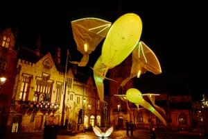 'Les Luminéoles', brightly coloured dream like fish floating in Market Square by Porte Par Le Vent