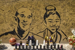 Notes are seen with a painted portrait of Kobe Bryant and Gianna outside the 'House of Kobe' basketball court in Manila.