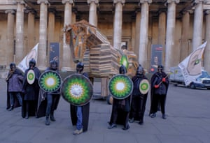 London, UK BP or not BP activists take a wooden Trojan horse into the courtyard of the British Museum in London with flags reading 'BP Must Fall'.