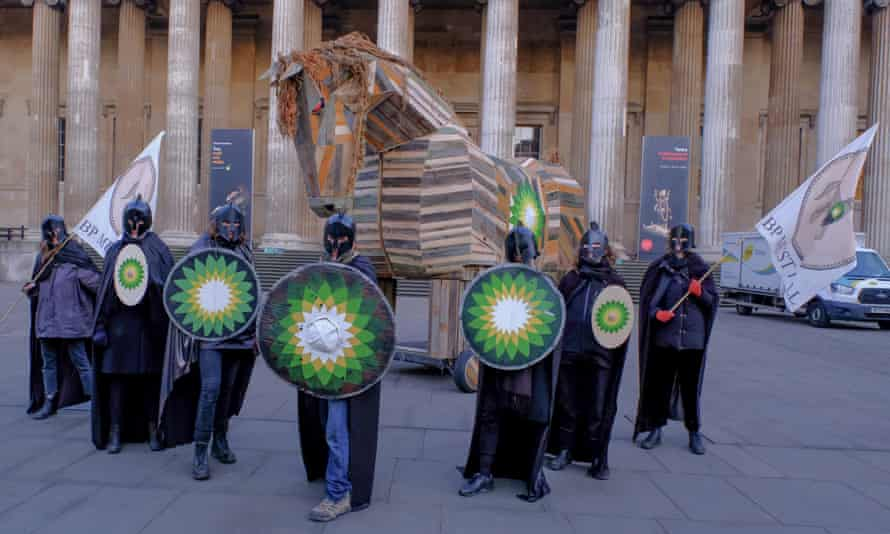 Activists dressed as warriors in front of wooden horse in the courtyard of the British Museum in London