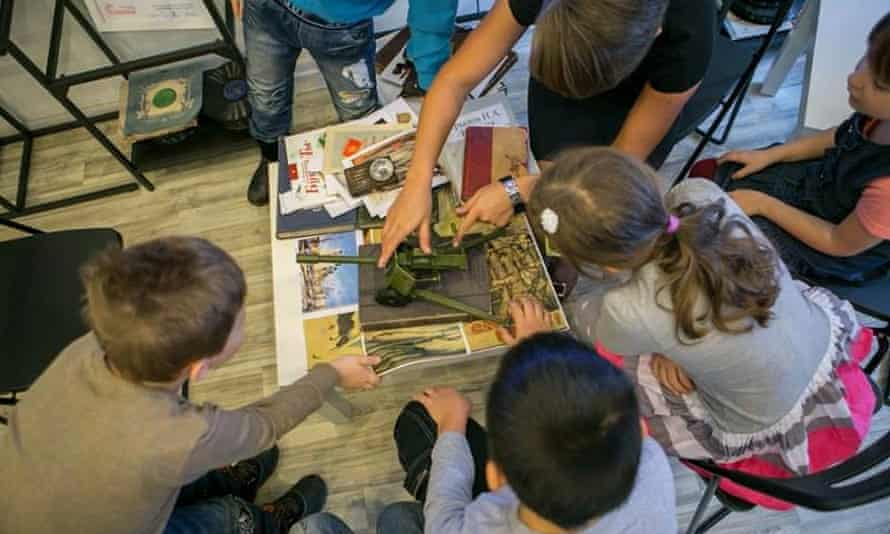 Children touch and play with exhibits at The Life of Leningrad 1945-1965 museum, St Petersburg