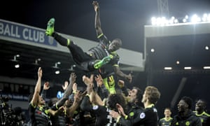 Chelsea's players throw N'Golo Kanté in the air after they clinched the Premier League title with victory over West Bromwich Albion at The Hawthorns