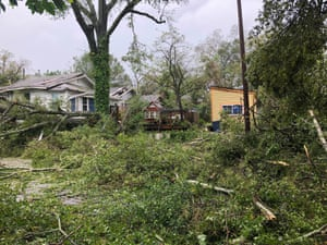 An entire block of homes are cut off by a puzzle piece of trees and roads in Wilmington , North Carolina.