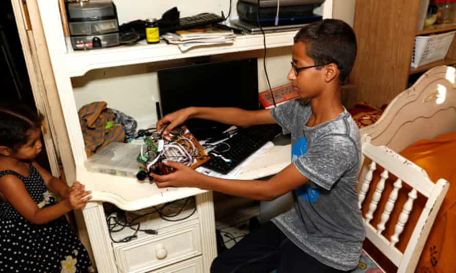 Ahmed Mohamed shows off some of his electronic equipment. He was handcuffed after his school called police over the digital clock he made which 'looked like a bomb' to a teacher