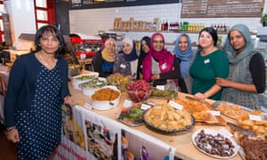 Kalpna Woolf, left, with some of the cooks and their food at the International Peace Cafe, Bristol.