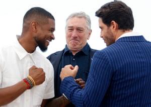 Usher, Robert de Niro and Edgar Ramirez pose during the photocall for Hands of Stone