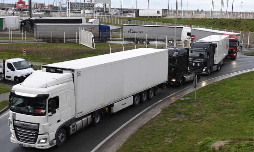 Trucks leave the ferry terminal in Calais as France and Britain reopened cross-border travel.