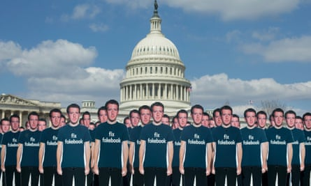 One hundred cardboard cutouts of Mark Zuckerberg at a protest in Washington, April 2018.