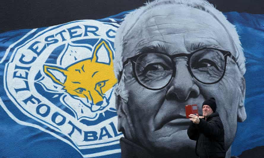 A man takes a picture in front of a mural of Claudio Ranieri in Leicester city centre.
