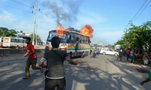 Jamaat-e-Islami supporters set fire to a bus in protest at sentences handed down by a war crimes tribunal in 2013