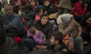 Refugee and migrant families queue to enter Macedonia at the Greek-Macedonia border near Idomeni, Greece.