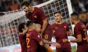 Radja Nainggolan is congratulated after scoring to put Roma 3-1 up on Juventus.