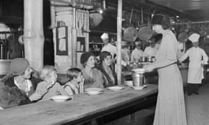 Eleanor Roosevelt serves food to unemployed women and their children.