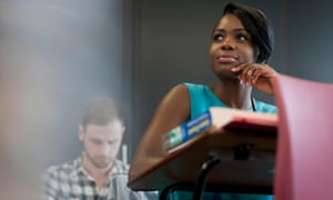 University student sitting at desk with hand on chin. Image shot 2014. Exact date unknown.<br>Female university student