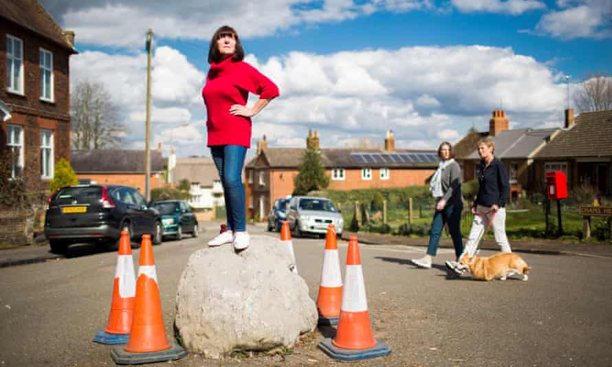 Standing their ground … local resident June Wright atop the Soulbury stone.