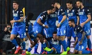 Empoli players celebrate their winner, scored by Giovanni di Lorenzo (No 2).
