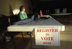 Sue Randle waits for voters to register at a polling place in Normal, Illinois on 17 March.