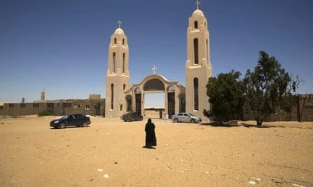 A priest enters an Egyptian monastery