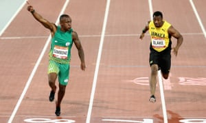 Akani Simbine, left, won the men's 100m final with a time of 10.03secs.