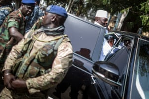 Yahya Jammeh gets back into his armoured car after casting his marble at a polling station in Banjul.