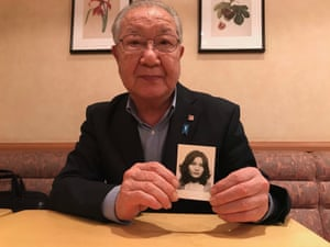 Shigeo Iizuka with a photograph of his younger sister, Yaeko Taguchi, who was abducted from Japan by North Korean spies in 1978.