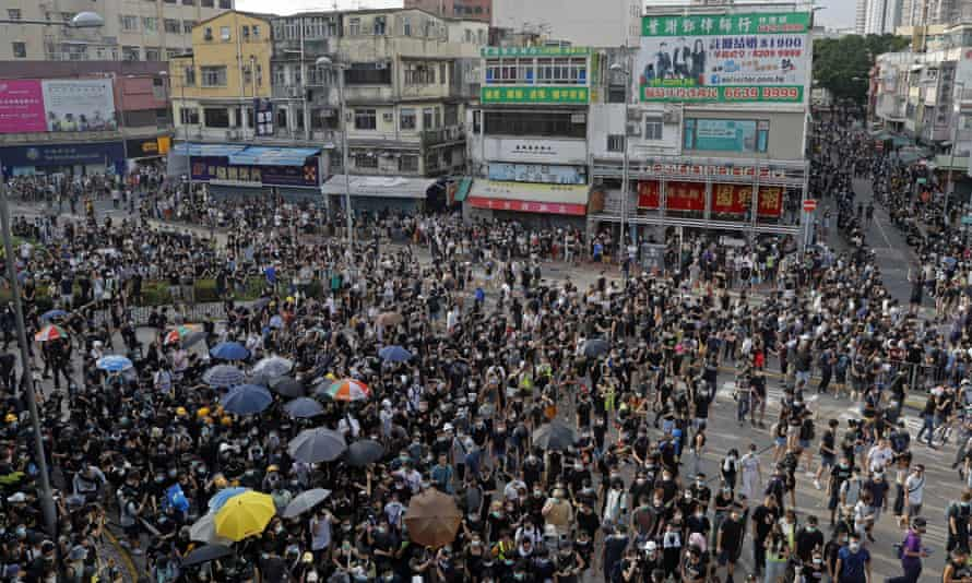 Protesters march in an area of Hong Kong popular with Chinese tourists for its pharmacies and cosmetic shops on Saturday.