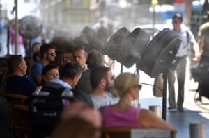Fans spray cold water on customers on the terrace of the Círculo de Bellas Artes bar in Madrid.