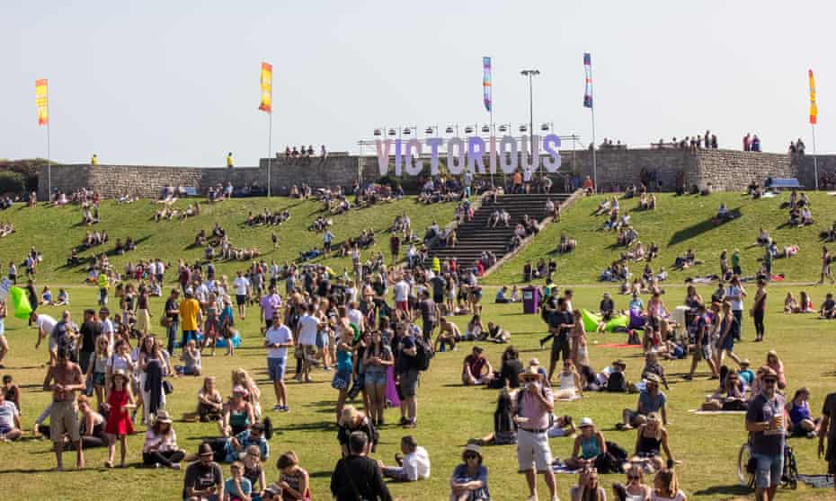 Victorious Festival landscape with people sunbathing and enjoying bands