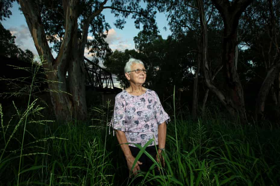 Elaine Samson stands by the Steel Bridge in Moree where she grew up living in the Steel Bridge Camp on the banks of the Mehi River.