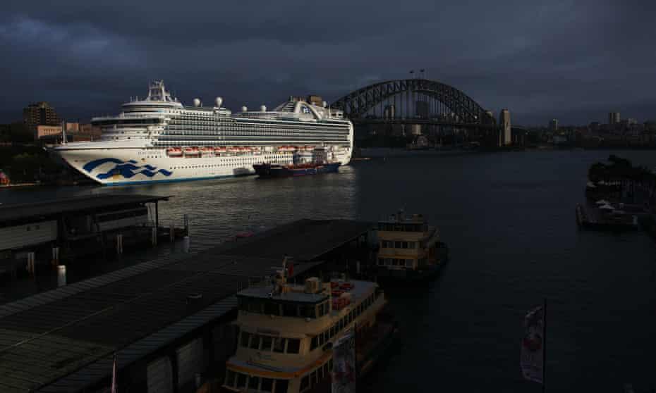 massive cruise ship at port at circular quay with harbour bridge behind